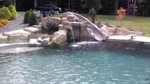 charlotte cool pool waterfall slide grotto design by creative rock