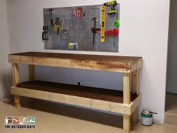 step by step diy wood garage work bench the outdoor boys hero diy garage work bench logo