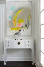 house tour an artist s super cool connecticut home decorology the piece above this console is probably my favorite painting of hers does that console look familiar i told you where to get it on sale last week see