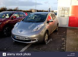 car nissan electric car nissan leaf garage isle of wight england uk stock