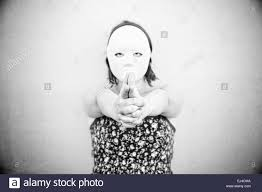 in white mask on halloween mystery stock photo royalty free