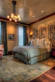 art deco bedroom designs with patterned bedding and chandelir and