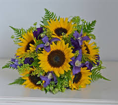 mini sunflower bouquet using purple clematis and lisianthus with