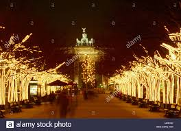 christmas trees lit up at night brandenburg gate pariser platz