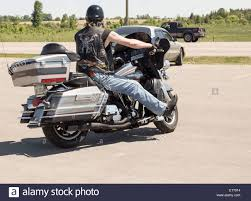 motorbike vest man on harley davidson motorcycle wearing leather vest with harley