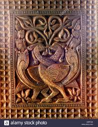 birds entwined sri lanka wood carving on supporting temple posts