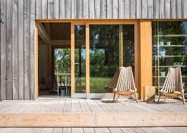 Small Lake House by Mny Arkitekter Uses Multiple Timber Finishes For Finnish Lake
