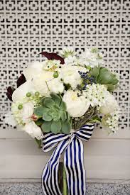 navy and white striped ribbon the bridal bouquet will be with a navy and white striped ribbon