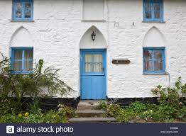 quaint brightly painted traditional cottage with gothic style