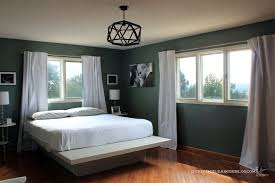 master bedroom painted blue sage from door