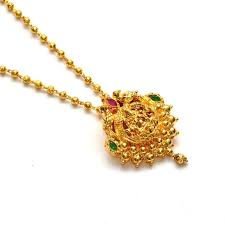 anvi s lakshmi pendent studded with emerald and rubies with gold