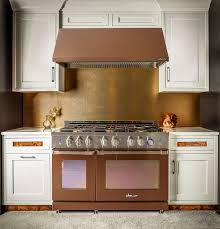 dwell design kitchen bath photo dacor released series calls alchemy the look display was warm pale red called rose gold nickel copper and gunmetal rounded out