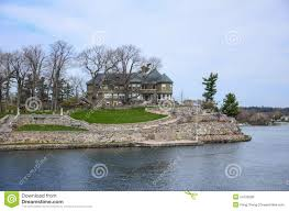 one small island and beach house on st lawrence river stock photo