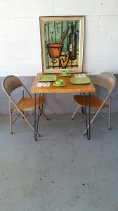 Craigslist San Jose Furniture by Bernard Buffet Lithograph Hangs Over A Vintage Hairpin Table And A