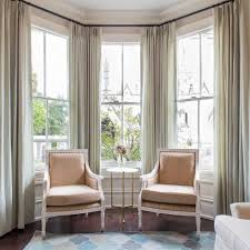 bay windows with long curtains and furniture instructions to