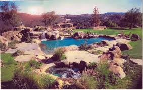 Swimming Pools Designs by Swimming Pool Designs With Rocks Video And Photos