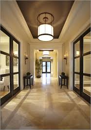 wooden glass sliding doors interior metal framed drum high ceiling foyer lighting with two