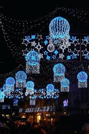 and white christmas lights blue and white christmas lights decorate tree outdoor