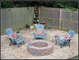 easy and cheap diy fire pit ideas with stone bricks and gravel for