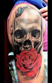 collection of 25 roses and skull tattoos on arm