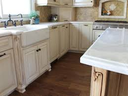 white kitchen cabinets with farm sink antique white cabinetry with farmhouse sink hgtv
