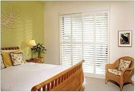 interior white sliding glass door plantation blinds with wooden