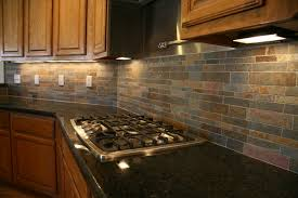 interior brown natural brick kitchen backsplash combined with