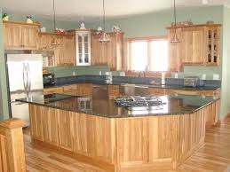 what paint color goes best with hickory cabinets what color should my kitchen backsplash be in order to