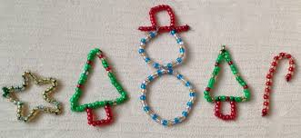 child made bead ornaments here come the girls