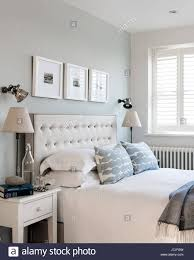 mimosa upholstered buttoned headboard by loaf in bedroom with