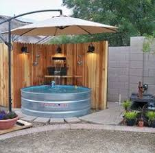 Backyard Oasis Ideas by Setting Up A Stock Tank Pool Keep Cool Pinterest Stock Tank