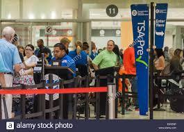 long lines of air travelers pass through tsa precheck as agents