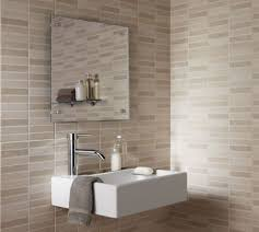 bathroom designed with mounted sink and ceramic tiles with neutral