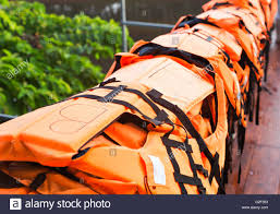 life jackets in orange colours stock photo royalty free image