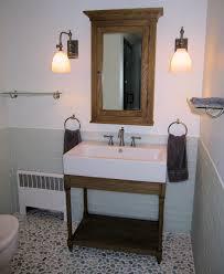 white pebble tile shower floor wood floors
