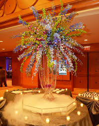 tropical orchid centerpiece with smokey dry ice effect wedding