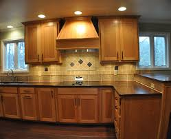glamorous kitchen colors with light brown cabinets white hang lamp