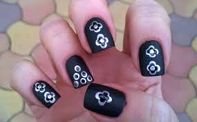 life world women black matte nail art with silver dotted design