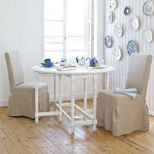 simple dining room interior design with white round dining table