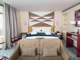 luxury hotel abidjan sofitel abidjan hotel ivoire prestige suite king size bed lagoon views balcony spacious bedroom and separate lounge