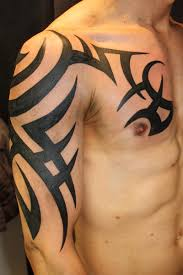 chest and tribal on right half sleeve