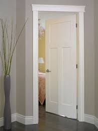 white interior doors with glass interior doors white trim and door topper paired with a two