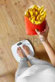 diet and fast food concept overweight woman standing on weighing