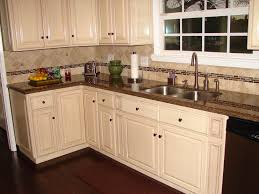 brown and white kitchen cabinets antique white raised panel cabinets and tropical brown