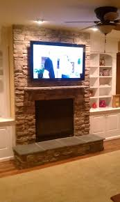 interior stone firepace design ideas with mounting tv above