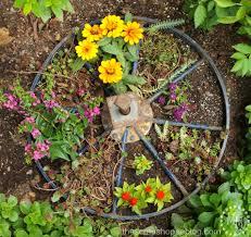 wagon wheel planter the scrap shoppe
