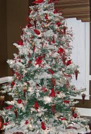 love this flocked white christmas tree with a flock of red
