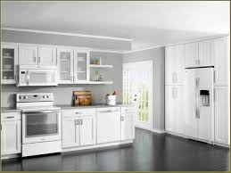 brown painted kitchen cabinets with white appliances caruba info