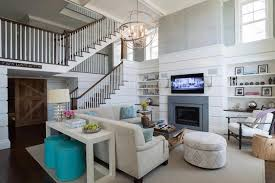 two story living room fireplace with bookcases transitional living room alisberg