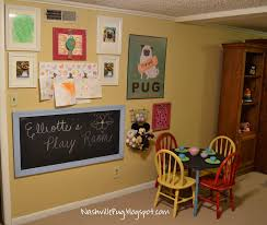 basement playroom ideas with round dining table set and cabinet